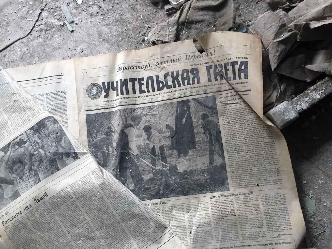 An old newspaper on the floor.